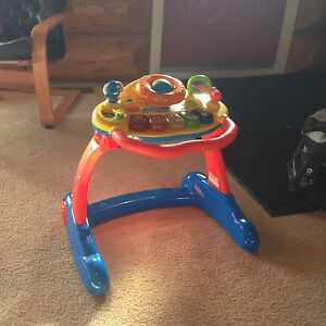 V tech  and Fisher Price stand play table