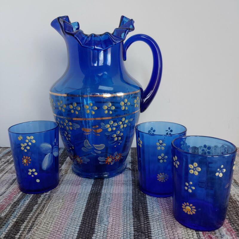 Victorian cobalt blue lemonade pitcher and three matching tumblers