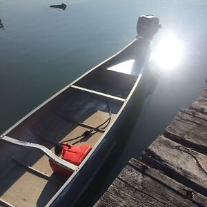 Square stern canoe and motor