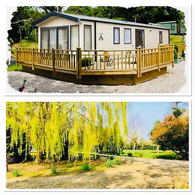Great open plan holiday home for sale with L shaped deckin, big price reduction!
