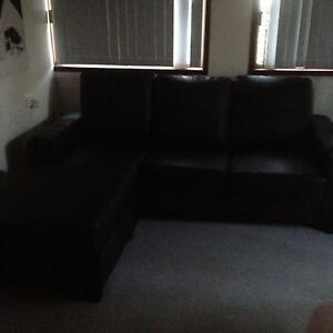 Black 3 seater  ( non leather ) but looks like  with  chaise Buff Point Wyong Area Preview