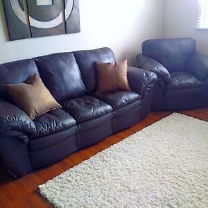 Soft and luxurious black leather full size sofa and armchair