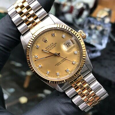 Gents Rolex Datejust in Steel and 18ct Gold with Factory Champagne Diamond Dial.