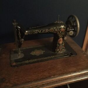 Antique sewing machine and stand