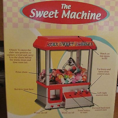 "The Electronic Arcade Claw Grabbing Candy ""Sweet Machine"""