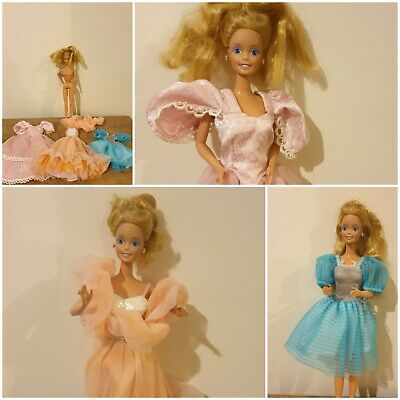 Vintage Barbie Doll with 3 Dresses Including Peaches And Cream