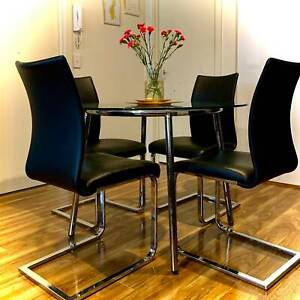 Round Glass Dining Table with Four Chairs