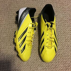 Yellow, black, and white adidas f5 cleats