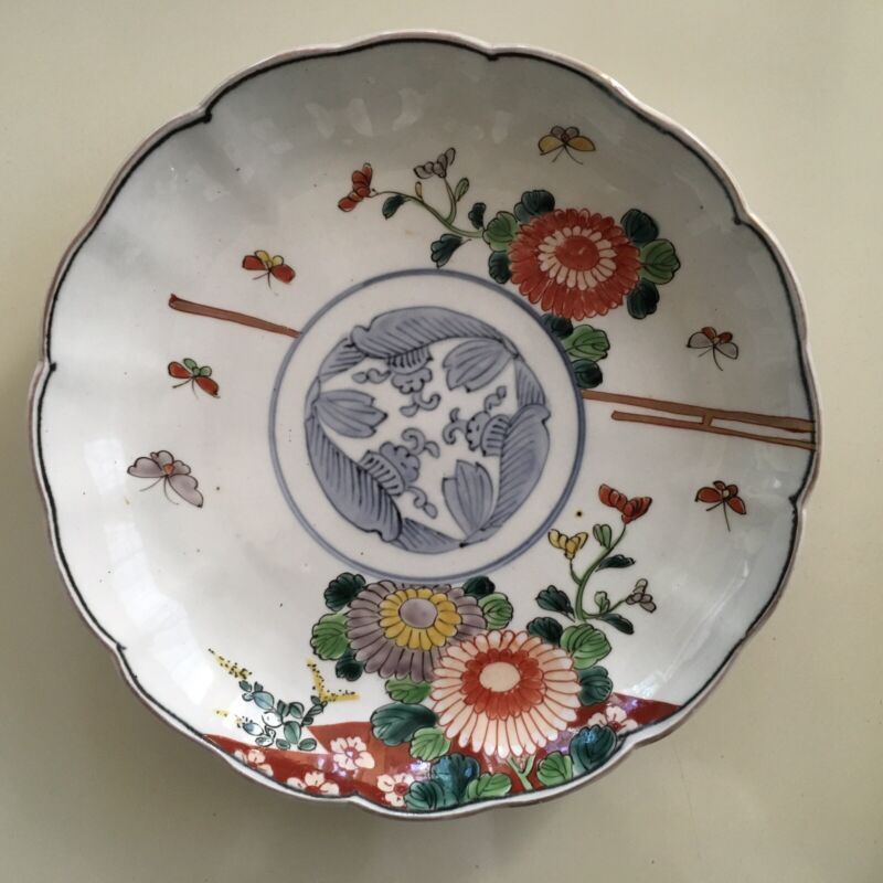 Antique Arita Imari food bowl with Chrysanthemums and butterflies Early 19c