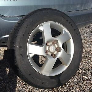 """Nearly new Uniroyal All Season tires on 16"""" Alloy rims only $290"""
