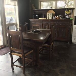 Antique Italian walnut dining table and chairs