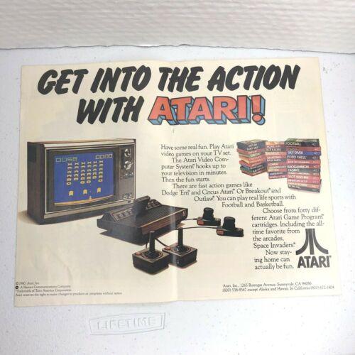 1980 ATARI 2600 video game Space Invaders stack of cartridges vintage print Ad