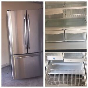 Can deliver/ GE stainless steel fridge & stove self clean