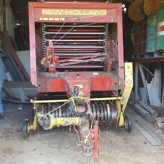 Hay baling system. Round baler, disc mower and rake