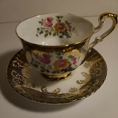 A Paragon fine bone china  jug with  a green and pink pattern  and a gold rim around the top and base
