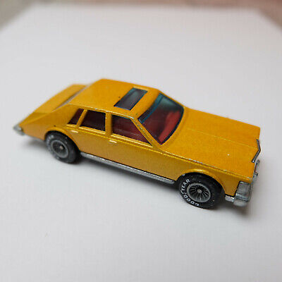 Vintage 1980 Hot Wheels Cadillac Seville – Diecast Car Metallic Gold Flake