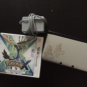 Nintendo 3DS XL, charger, Pokemon X, and 32 GB SD card