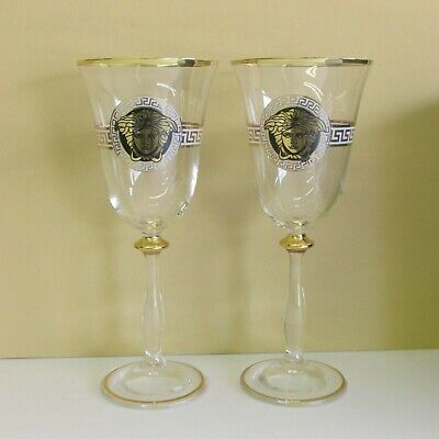 VERSACE PAIR OF CLEAR WINE GLASSES  IN GOLD FINISH