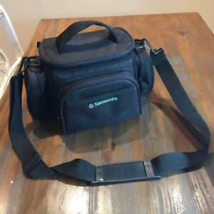 Camera bag with multiple pockets , fits DSLR and Zoom lenses