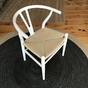 Two Wishbone dining chairs