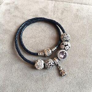 Pandora silver charms, clips, and bracelet