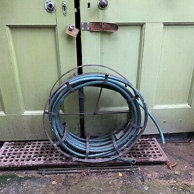 Antique wrought iron hose reel and hose