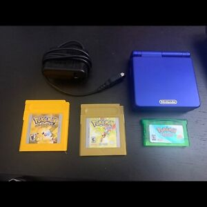 Game boy advance sp with Pokémon yellow, gold and emerald