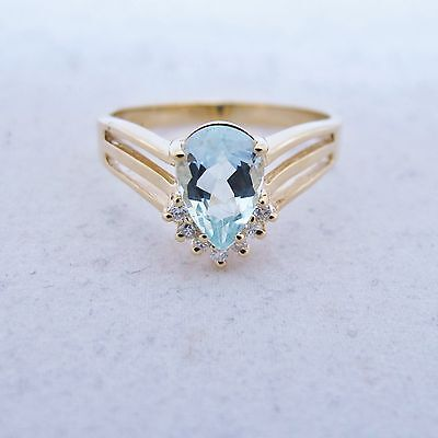 14K Gold Ring with 9mm Aquamarine & 7 Diamonds  (3.6 grams, size 9)