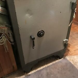 VINTAGE ANTIQUE STEEL FLOOR SAFE ON WHEELS. Estate Sale