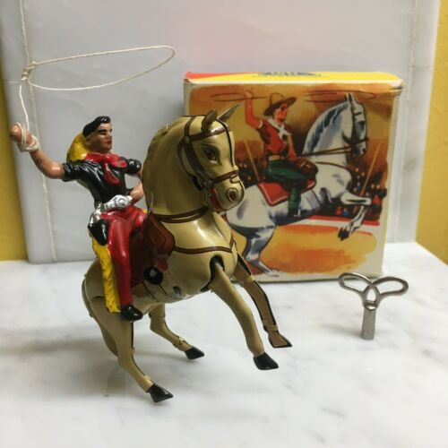 GKN AKA: G. KOHLER OF NUREMBERG TIN CLOCKWORK COWBOY W/LASSO BOX AND KEY! SWEET!