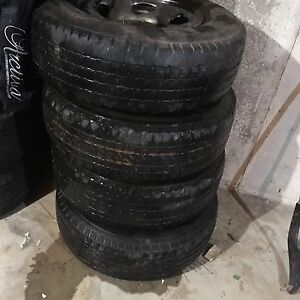 4- 245x75x65 tires and rims