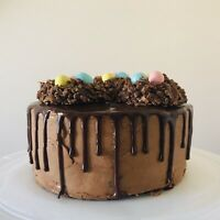 Chocolate Easter drip cake with mini egg nests!