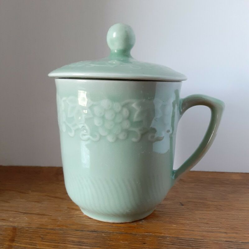 Celadon grape vine embossed pattern Coffee/tea Cup With lid