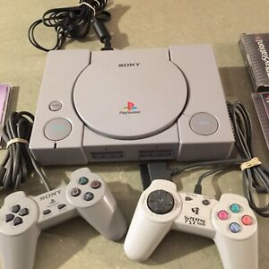 PlayStation with games (resident evil 2 contra and more)