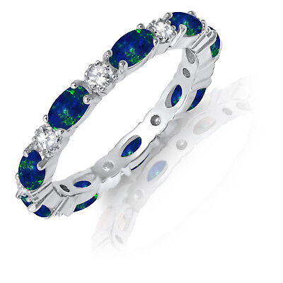 - Oval Dark Blue Fire Opal Eternity Simulated Diamond Genuine Silver Ring