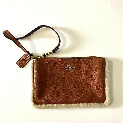 COACH Brown Crossgrain Leather Mini Sherpa Wristlet