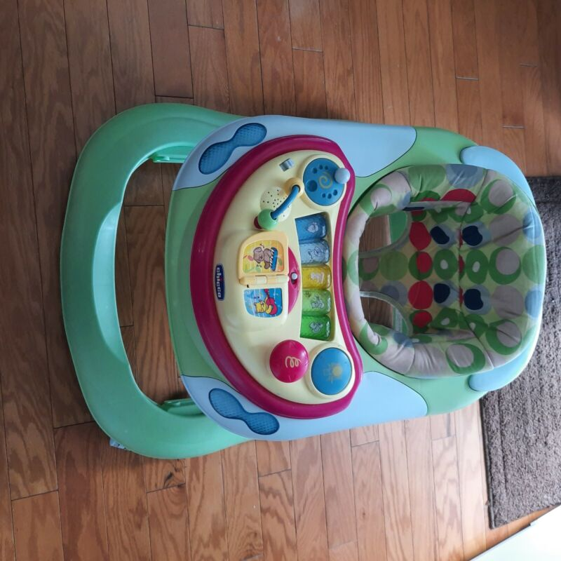 Used musical multi-colored Chicco baby walker