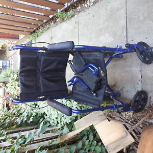 Fairly new good quality wheelchair with pedals blue navy in colo