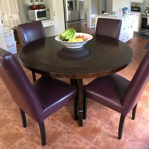 Like new solid wood dining table with 4 leather chairs