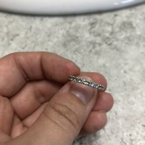 Size 4- 14K white gold band with 11 stones
