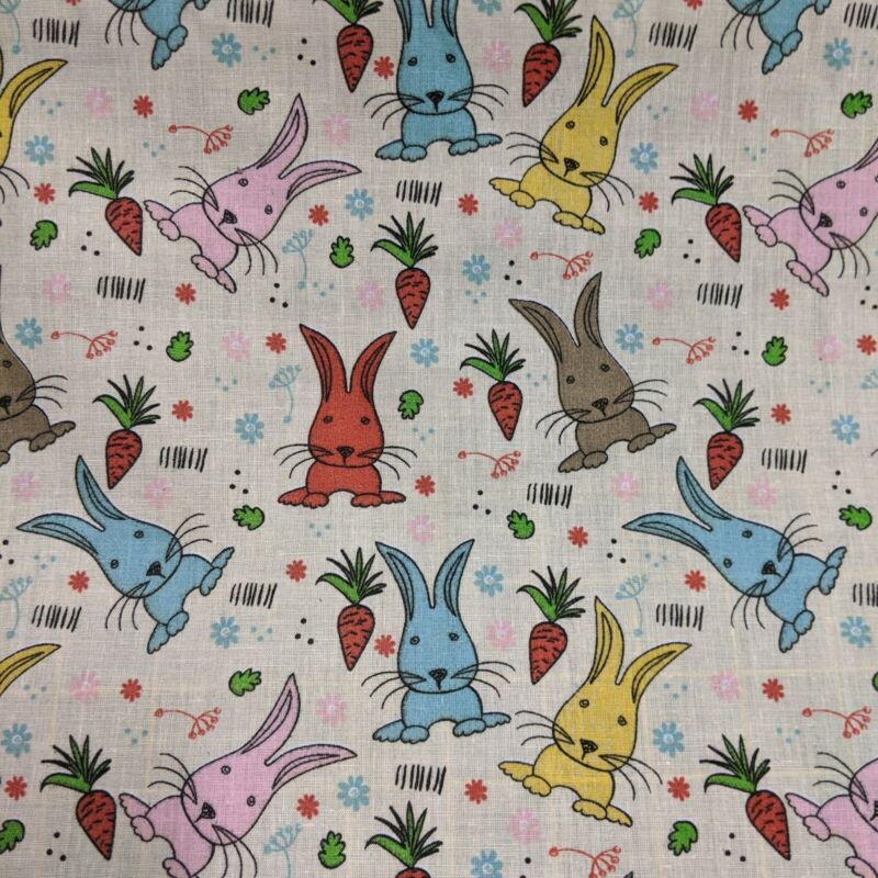Polycotton+44%E2%80%9D+Wide+By+The+Metre%2C+colourful+bunny+rabbits+on+a+cream+background