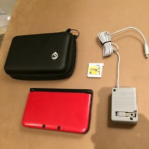 Red Nintendo 3DSXL console with Zelda game