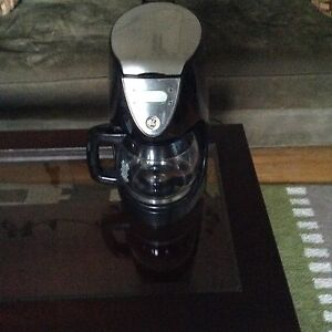 Black and stainless steel coffee pot