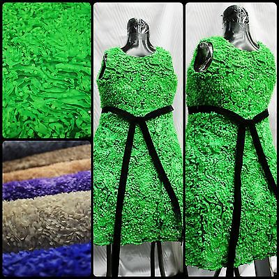 Green, fancy puffy 3D flower fabric with sequin on the polyester mesh. (Rosette)