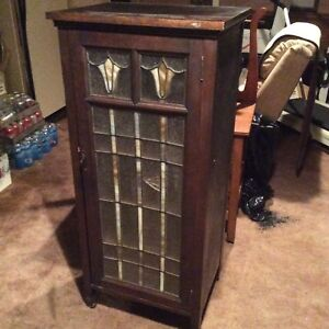Vintage piano roll cabinet