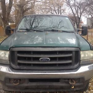 2002 Ford f 250 and 14' gator USA dump trailler