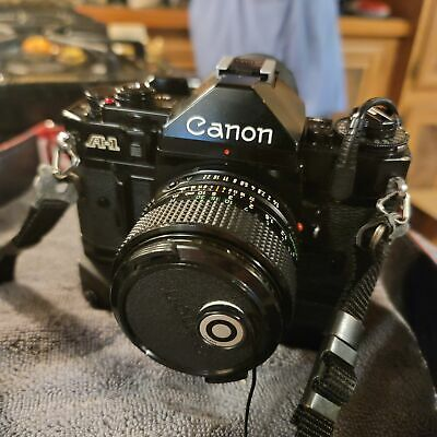 Canon A-1 Vintage Camera with Bag and Acc.