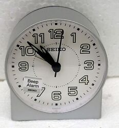 SEIKO -  SILVER ROUND WHITE FACE QUIET SWEEP ALARM CLOCK  QHE084SLH