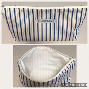 White and blue stripe pouch