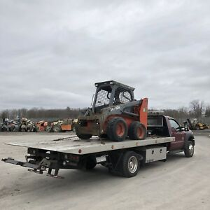 FLATBED TOWING SERVICE - AUTO EQUIPMENT MACHINERY HAULING
